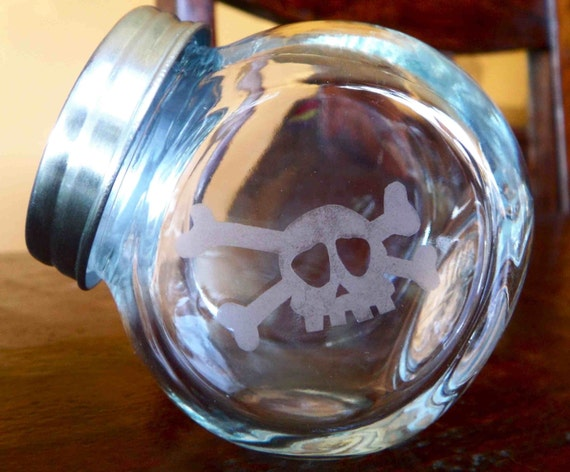 Three Small Skull Etched Glass Canisters