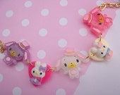 Adorable Sugarbunnies and Hearts bracelet purple white and pink