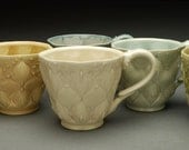 Stamped cup, ivory