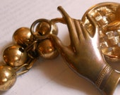 Victorian Lady's Hand with Baubles Brooch