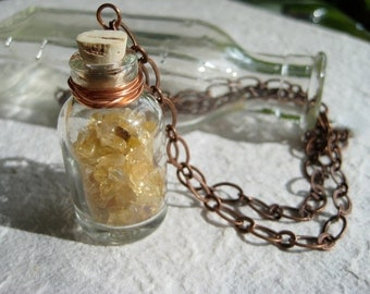Citrine chips in tiny glass bottle on a long copper plated necklace. Gemstone, geology, curiosity necklace