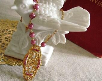 Victoriana . Golden Medallion, Raspberry Garnets, and Red Aventurine Briolette
