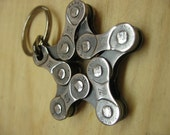 star shaped key chain charm made out of recycled bicycle chain