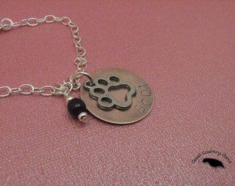 Personalized Hand Stamped Dog Bracelet with Paw and Garnet Bead Copper and Silver