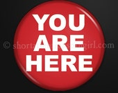You Are Here - 1-inch button as magnet, pinback, zipper-pull, or lapel pin