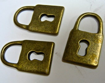 bronze Padlock lock keyhole vintage style  small  quantity  four (4)     jewelry findings  N5