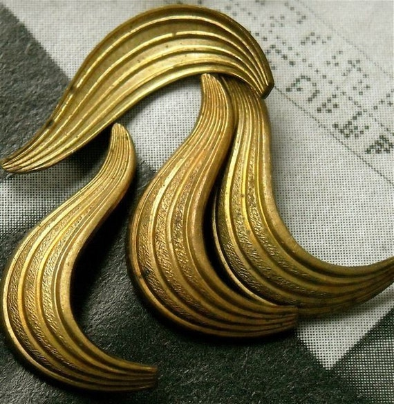 very old vintage brass findings stampings    nyc4 quantity four  swirl curve or leaf paisley