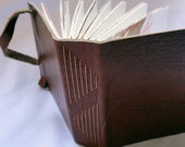 Small leather journal in tan with hand-stitched spine
