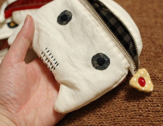 A cat eating a fish pouch with Sashiko stitch