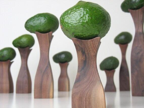 The Stand (8 sculptural and modern walnut wood display pedestals) .....
