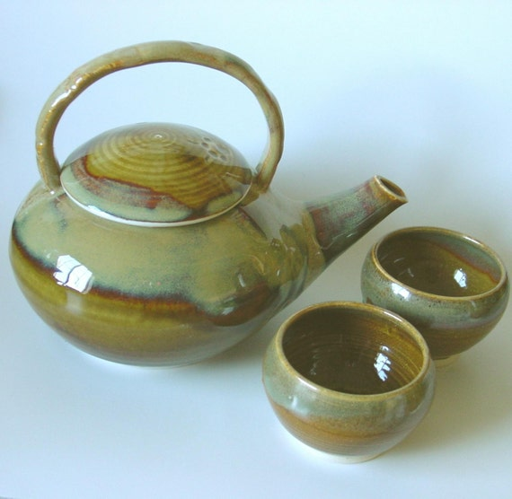 Amber Tea Pot and Two Tea Bowls with blue green highlights.