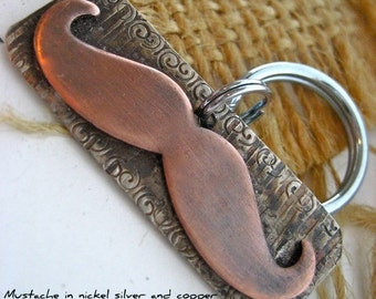 Our dog tags make a unique personalized gift. Each pet id tag is crafted in our Bozeman, Montana studio by dog lovers. Mustache Pet Tag