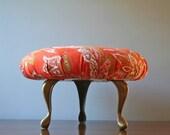 vintage reupholstered foot stool vintage orange floral fabric