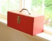 vintage metal tool box in red