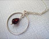 Minimalist Sterling Silver Garnet Necklace. Simple Circle Drop Necklace