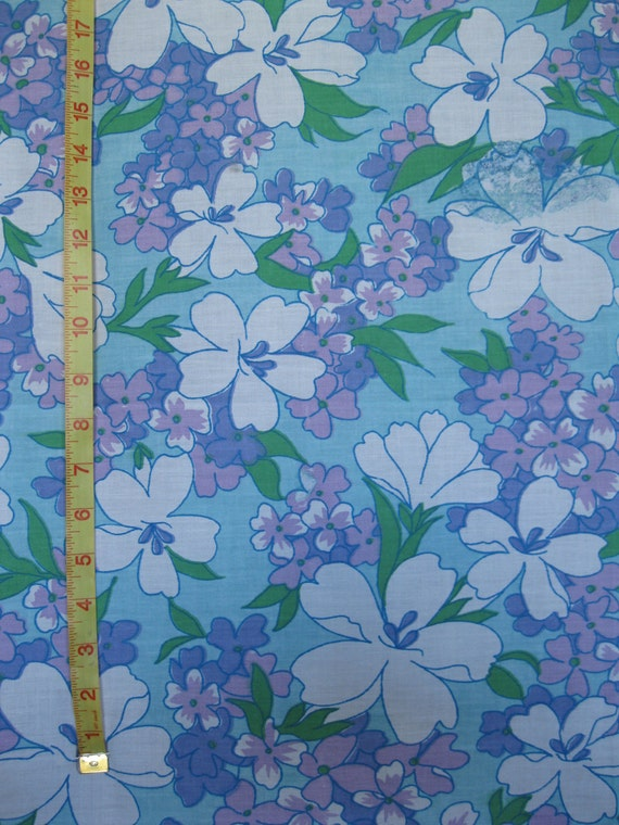 1960's floral print fabric in cyan, two shades of purple, green, and white