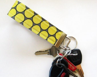 Key Fob in Gray and Yellow Huevos