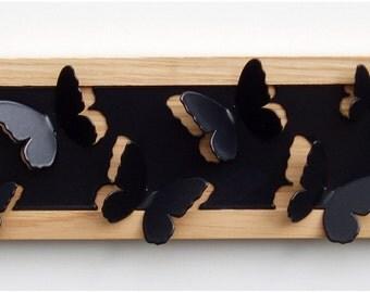 Butterfly Jewellery Hanger in black powder coated steel and oak