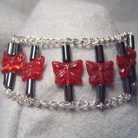 Eight Red Butterflies, glass, hematite and chain bracelet