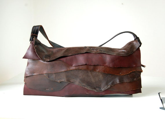 Dark brown leather shoulder bag with natural layered front, handmade.