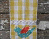 Yellow gingham dish towel with bird applique