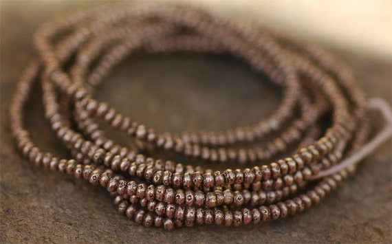 Tiny Hill Tribe Silver Rondelle Beads -- 24 inch Strand