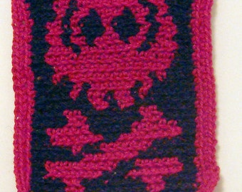 Skull and bones patch in crocheted black and red cotton