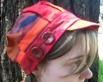 Cotton canvas engineer cap in funky swirls of red, orange, tan and navy