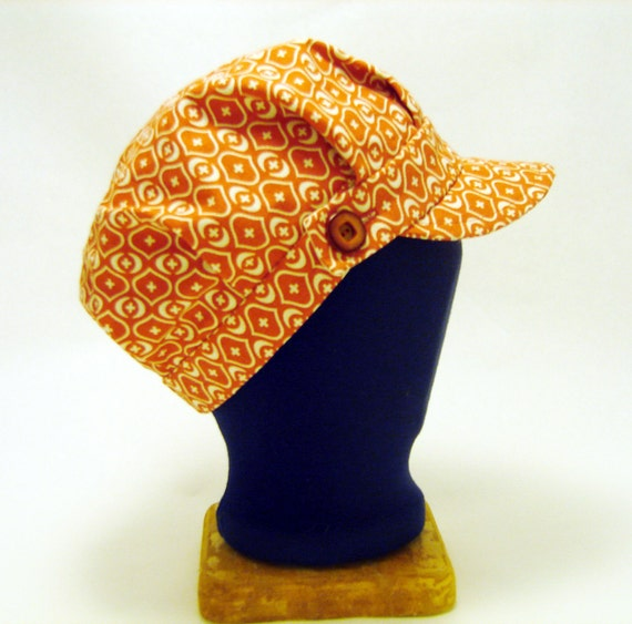 Orange engineer cap with buttoned band and geometric print