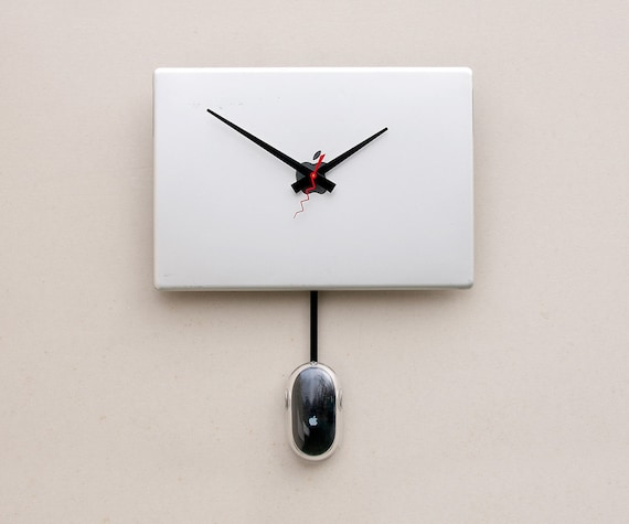 Clock created from a recycled Apple Powerbook laptop cover