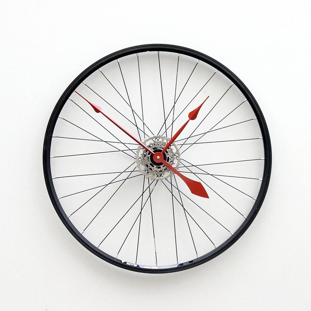 Clock made from a recycled bike wheel for Bicycle wheel wall art