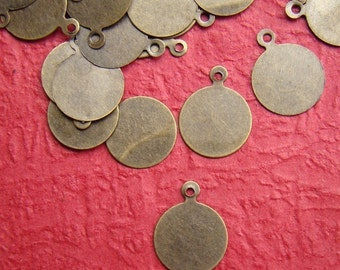 100pcs 10mm Antique Bronze Cabochon Tags Charm Drop CWD108