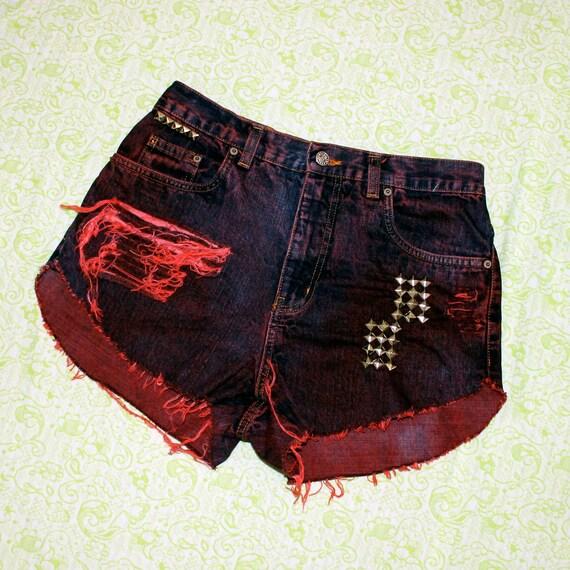 red wash shredded studded denim shorts