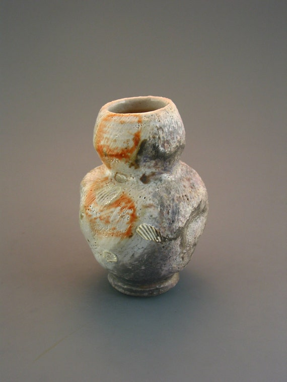 Ikebana Vase, wood-fired stoneware, side wadded on shells w/ crawling shino and natural ash glazes