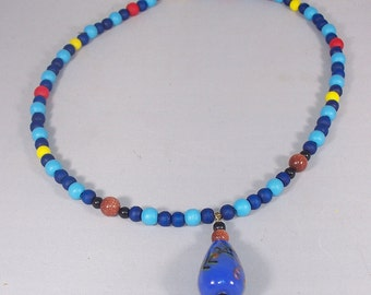 Drop Necklace Featuring Goldstone, Wood, Czech Glass, and Painted Ceramic Beads