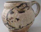 Mug with rabbits wood fired salt glazed stoneware