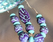 Tokelau - Lampwork Focal, Round and Donut 18 Bead Set, SRA