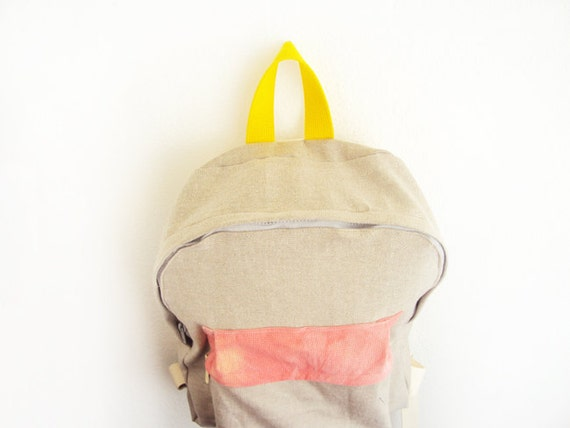 Light brown denim backpack with coral dyed pouch