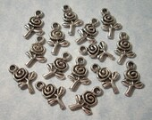 25 Tiny Flower Charms 9mm x 16mm
