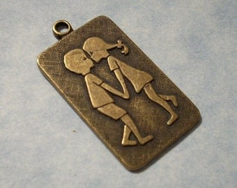 Kissing Couple Pendant Oxidized Brass 16mm x 25mm