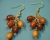 Reserved for Lisa Goulette-Neuberger Pair of earhangings made of vintage 1940s opque tested bakelite plastic beads w goldcolor metal details
