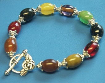 Unique one-of-a-kind multicolor bracelet with genuine tested vintage 1940s bakelite beads and rose toggle clasp
