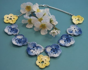 Unique one-of-a-kind necklace of marbled blue and yellow chrochet cotton yarn violet flowers