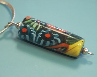 Unique one-of-a-kind pendant necklace with handblown tubeformed vintage 1980s multicolor glass pendant and thin silvercolor metal chain