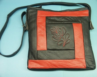 Unusual one-of-a-kind new/unused shoulderbag of clear red/black skin/leather in my own design