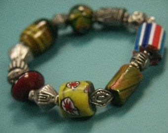 Lovely unique one-of-a-kind stretch bracelet of metal and handblown glass beads