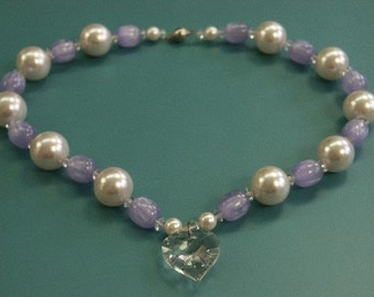 Unique one-of-a-kind handmade beaded necklace of white faux mop glass/lilac plastic beads with faceted glass heart pendant