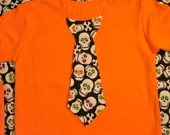 Skulls Halloween Appliqued Tie Shirt in orange - size 12 months to size 6 - long or short sleeved available
