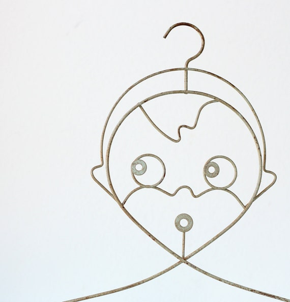 Vintage Hanger with a Face