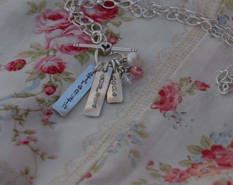 Hand stamped necklace with hand made tags...3 little words for survivors but can be made as a mommy necklace too
